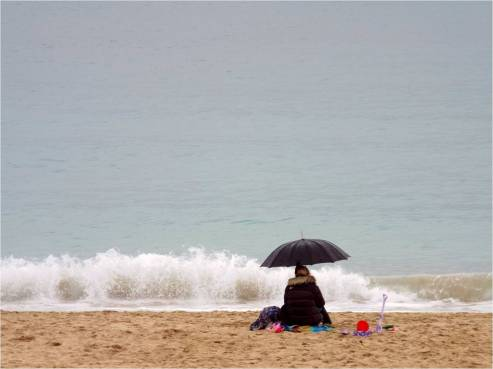 Woman on the beach in St Ives, Cornwall -photo by Katie @ Second-Hand Hedgehog travel blog