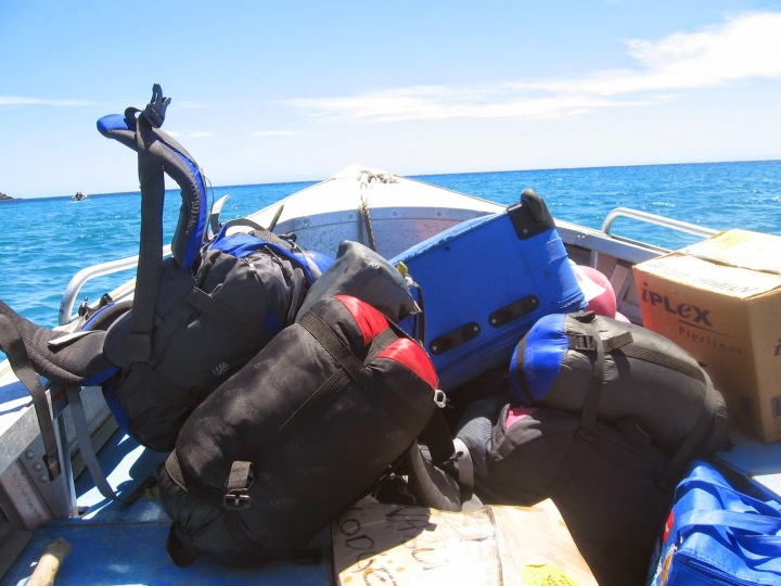 Suitcases on a boat heading for the horizon, Yasawa Islands, Fiji