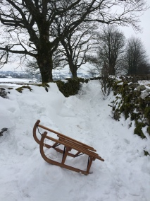 Snow in Cumbria - sledge in a laneway