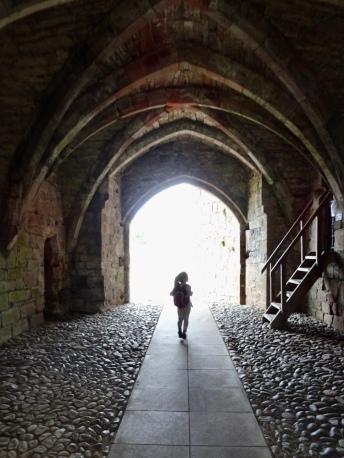 Little girl exploring a castle