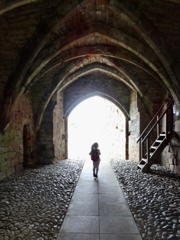 Little girl exploring a castle