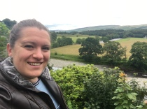 Katie Hale looking at the camera with a landscape behind