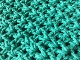 teal coloured crochet stitches - close up