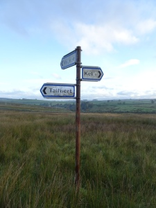 finger signpost in the middle of the fell, pointing towards Keld, Tailbert and Rayside