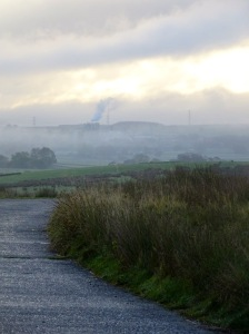 misty morning with a road leading across the fells